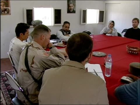 april 2004 meeting of provincial reconstruction team attended by us state department representatives us military personnel and delegates from... - provincial reconstruction team stock videos and b-roll footage
