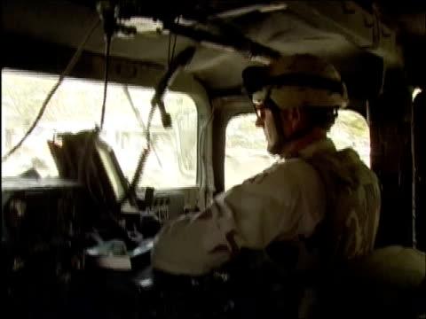 april 2004 us army soldier driving humvee through street in ghazni afghanistan - humvee stock videos & royalty-free footage