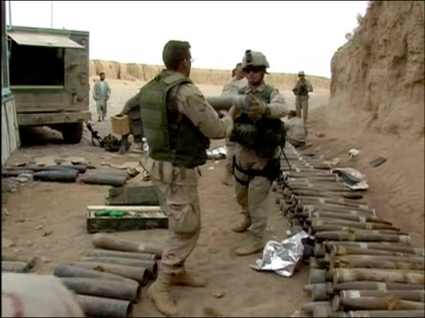 april 2004 us army soldiers of 10th mountain division passing munitions down line to stack against fortified wall in ghazni afghanistan - afghanistan stock videos & royalty-free footage