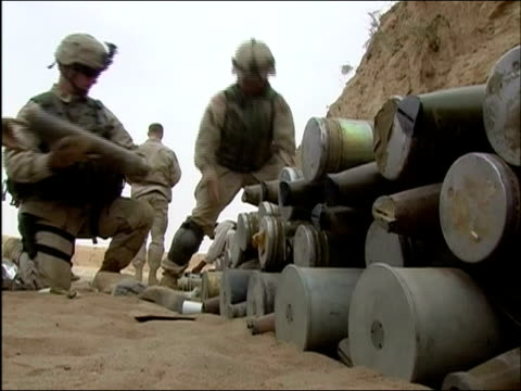 april 2004 us army soldiers of 10th mountain division stacking shells against fortified wall in ghazni, afghanistan - afghanistan stock videos & royalty-free footage