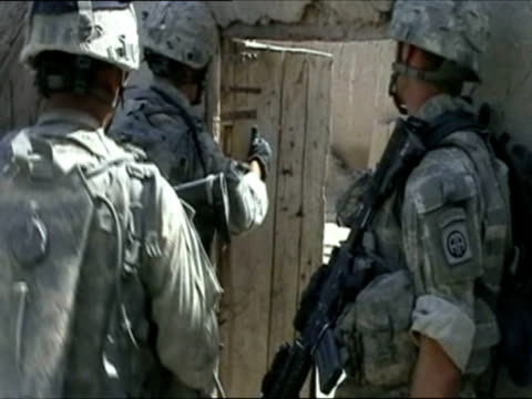 april 2007 montage u.s. soldiers on patrol, searching open compounds and breaking locked doors down to enter and search area/ afghanistan/ audio - kicking stock videos & royalty-free footage