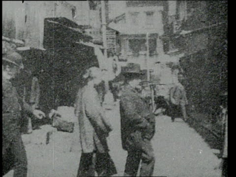 vídeos de stock e filmes b-roll de april 24, 1903 ws people walking in chinatown street, dressed as ordinary americans - 1903