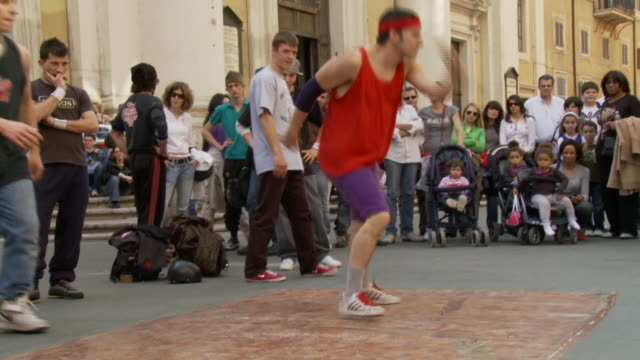 april 24, 2006 break dancers performing in front of a crowd in a piazza overlooked by a palace with corinthian columns / rome, italy - fairground stall stock videos & royalty-free footage