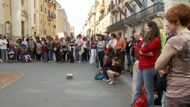 april 24 2006 montage break dancers performing in front of a crowd of people / rome italy - schießbude stock-videos und b-roll-filmmaterial