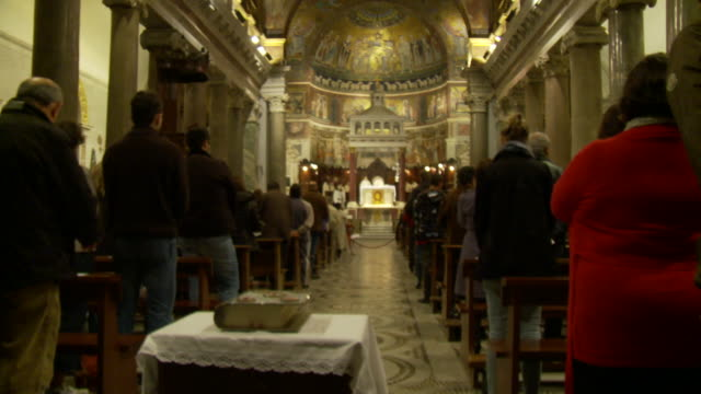 april 24, 2006 montage church aisle surrounded by standing congregants during mass / rome, italy - fairground stall stock videos & royalty-free footage