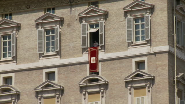 april 24, 2006 pope performing weekly service from a window in st. peter's square / vatican city, rome, italy - fairground stall stock videos & royalty-free footage