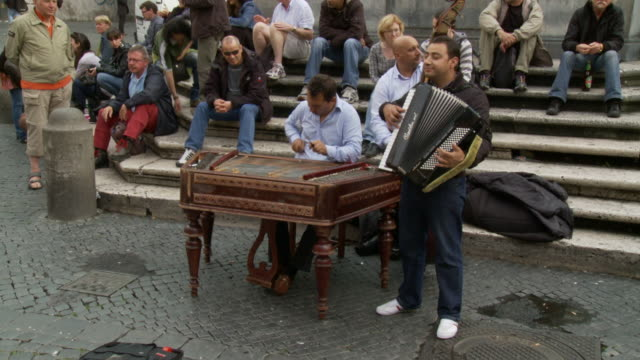 april 24 2006 ws street musicians playing in front of seated audience / massachusetts united states - schießbude stock-videos und b-roll-filmmaterial