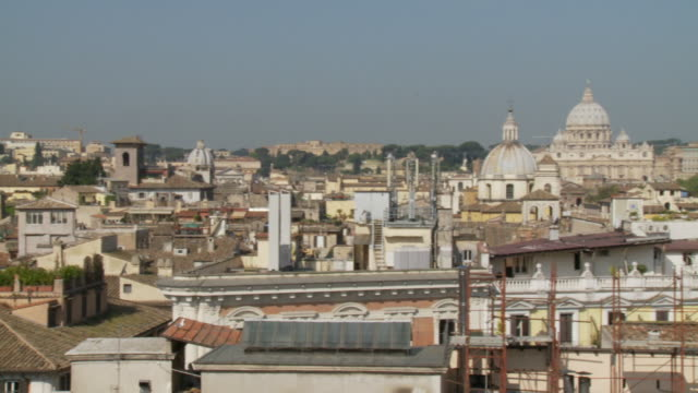 april 24 2006 pan vatican city including the dome of st peter's basilica / rome italy - schießbude stock-videos und b-roll-filmmaterial