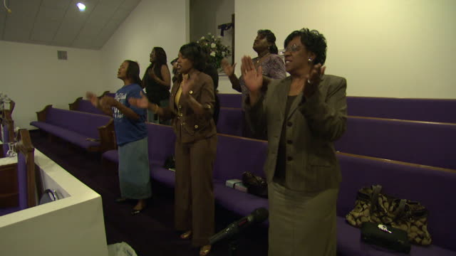april 24 2010 pan women singing and clapping in church / mississippi united states - congregation stock videos and b-roll footage