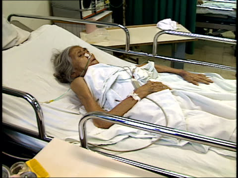april 25, 1987 patient lying in bed in hospital room / managua, nicaragua - マナグア点の映像素材/bロール