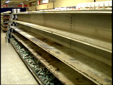 stockvideo's en b-roll-footage met april 25 1987 pan two long supermarket shelves one fully stocked with loaves of bread and the other shelf empty / managua nicaragua - managua
