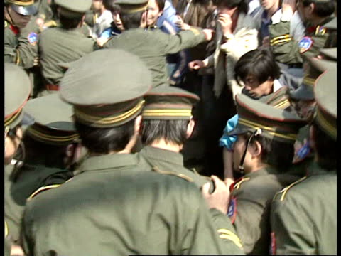 april 27 1989 film montage ms pan rows of police pushing back tiananmen square protestors/ beijing china/ audio - tiananmen square stock videos & royalty-free footage