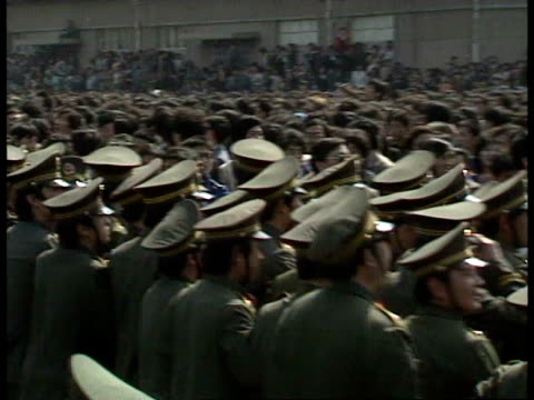 vídeos de stock, filmes e b-roll de april 27, 1989 film montage rows of police pushing back tiananmen square protestors/ beijing, china/ audio - 1980 1989