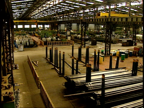 april 27, 1994 factory warehouse interior stocked with metal tubing and strips / south africa - warehouse点の映像素材/bロール