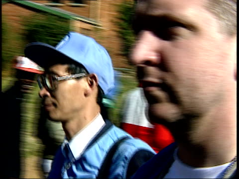 april 27 1994 ts un peacekeepers walking past voters during the first allrace election / johannesburg gauteng south africa - anno 1994 video stock e b–roll
