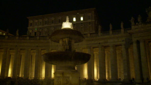 april 28, 2010 water in bernini's fountain glowing in the night in front of st. peter's square windows / vatican city, italy - basilica video stock e b–roll