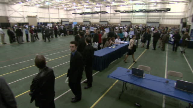 april 29 2009 pan hopeful applicants waiting in line at a job fair / warren michigan united states - unemployment stock videos and b-roll footage