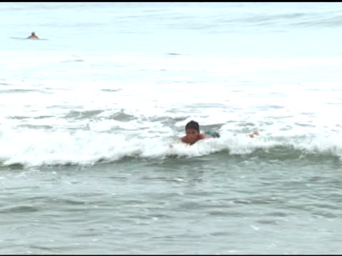 april 3, 2007 montage beginner learning to surf on small, mushy waves / puerto escondido, oaxaca, mexico - letterbox format stock videos & royalty-free footage