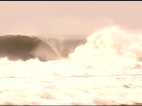 april 3, 2007 montage surfers dropping in on different waves / puerto escondido, oaxaca, mexico - letterbox format stock videos & royalty-free footage