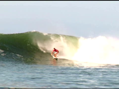 april 3, 2007 surfer catching wave and front side carving through wave break / puerto escondido, oaxaca, mexico - letterbox format stock videos & royalty-free footage
