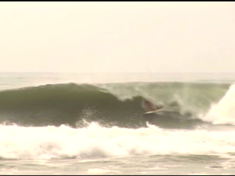 april 3, 2007 surfer riding in barrel of wave and bailing when the wave breaks / puerto escondido, oaxaca, mexico - letterbox format stock videos & royalty-free footage