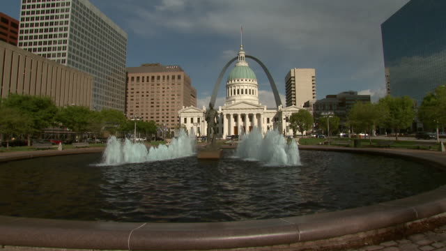 April 3 2009 WS Fountain in front of old St Louis Courthouse with Gateway Arch in the distance / St Louis Missouri United States