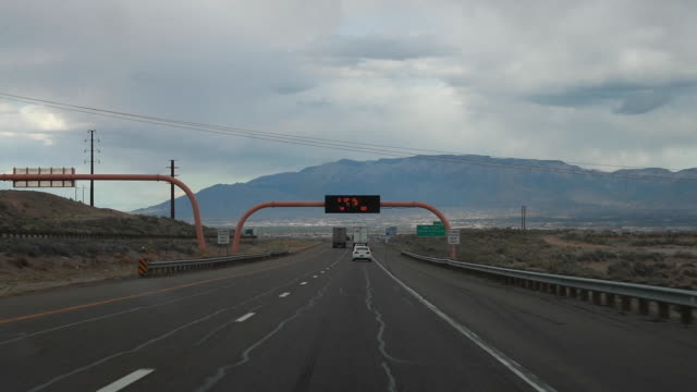 a highway information sign along i40 near albuquerque warns travelers to shop along and stop the spread of covid19/coronavirus friday april 3 2020 - albuquerque new mexico stock videos & royalty-free footage