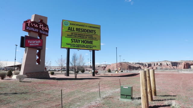 the the fire rock navajo casino is closed and a sign warns the navajo nation to stay home during the covid19/coronavirus emergency in gallup new... - navajo culture stock videos & royalty-free footage