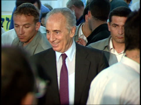 april 30 1992 zo shimon peres greeting supporters and shaking hands during campaign / israel - シモン・ペレス点の映像素材/bロール