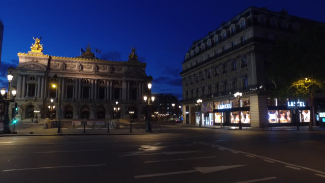 april 30 2020 in paris france in front of the paris opera house closed during the confinement of the coronavirus on a thursday evening between 9 pm... - three people stock videos & royalty-free footage
