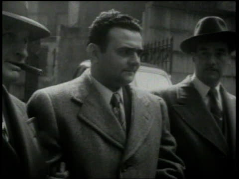 april 5 1951 montage david greenglass being brought to the federal building / new york city new york united states - whispering stock videos & royalty-free footage