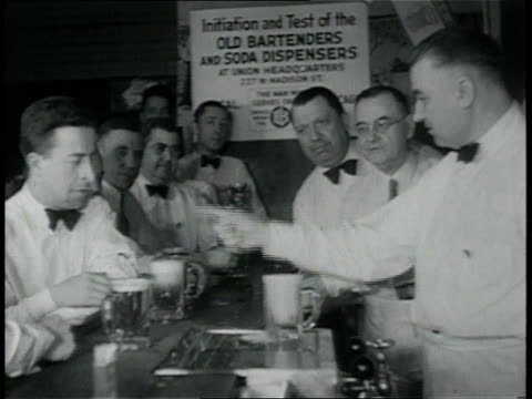 stockvideo's en b-roll-footage met april 6, 1933 montage bartenders in training, men stacking kegs, and delivery truck driving off / chicago, illinois, united states - 1933