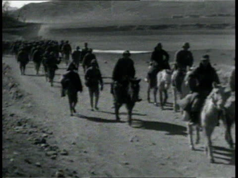 vídeos de stock, filmes e b-roll de april 6, 1933 montage column of chinese soldiers walking down dirt road, some on horseback / china - 1933