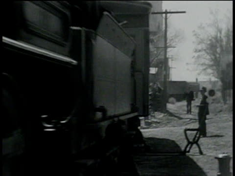 vídeos de stock, filmes e b-roll de april 6, 1933 montage ex-president hoover riding and disembarking train / virginia city, nevada, united states - 1933