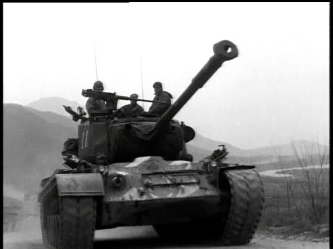 april 7, 1951 montage men riding on top of a moving tank / korea - 1951 stock videos & royalty-free footage