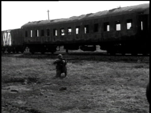 april 7, 1951 montage soldier firing rifle near train / korea - 1951点の映像素材/bロール