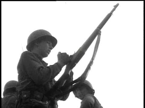 april 7, 1951 soldier loading rifle / korea - 1951点の映像素材/bロール