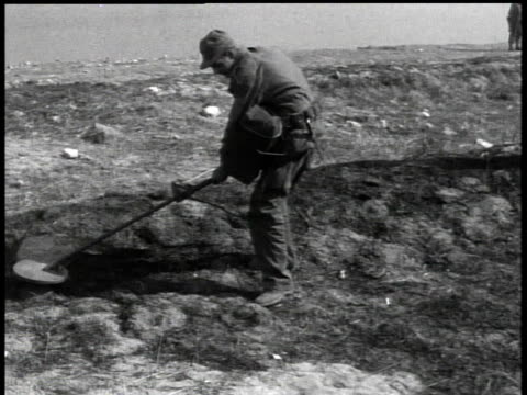 april 7, 1951 soldier searching for mines with metal detector / korea - 1951点の映像素材/bロール