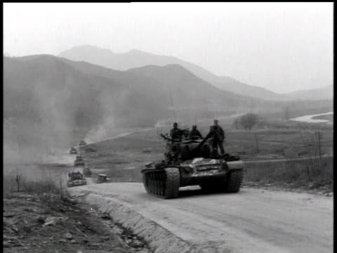 stockvideo's en b-roll-footage met april 7, 1951 soldiers riding on top of moving tank / korea - 1951