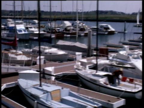 stockvideo's en b-roll-footage met april 7, 1968 montage boats tied up at pier / mexico - voor anker gaan