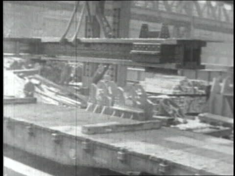 april 8 1930 ws finished empire state building beams being loaded on flatbed by crane for shipment / homestead pennsylvania united states - steel stock-videos und b-roll-filmmaterial