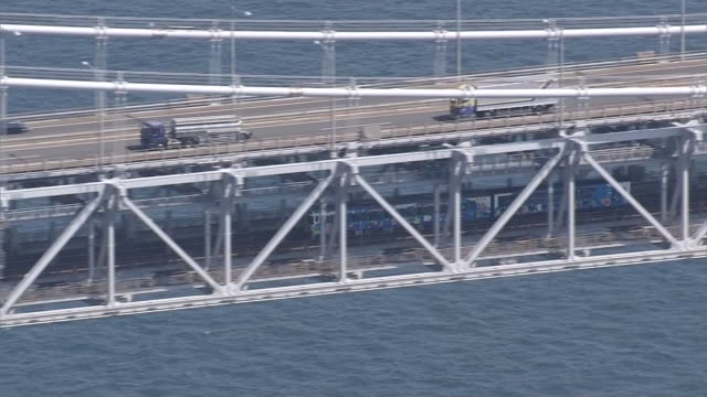 april 8 aerial shot of the great seto bridge or the seto ohashi closeup shot of a train crossing the bridge the bridge is a series of ten double deck... - honshu stock videos and b-roll footage