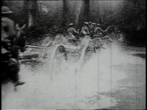 april 9 1915 british rushing reserves to flanders fields, galloping with caissons through river / flanders, belgium - british military stock-videos und b-roll-filmmaterial