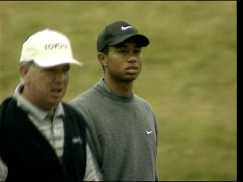 april in 1997 tiger woods became the youngest golfer to win the masters royal troon ext golfer tiger woods preparing to putt / sam torrance interview... - tiger woods stock videos & royalty-free footage