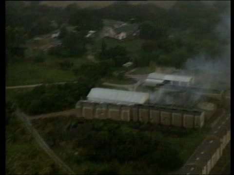april in 2000 white farmers in zimbabwe were attacked by supporters of mugabe int/ext victim in hospital / air views of smoke rising from burning... - blauer fleck stock-videos und b-roll-filmmaterial