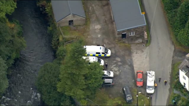 aerials of machynlleth wales powys machynlleth of local area including countryside woodland river houses parked police vehicles police officers along... - powys stock videos & royalty-free footage
