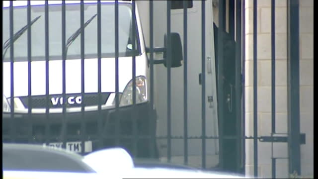 Mark Bridger appears in court Arrival WALES Aberystwyth EXT Police van reversing to police station / police officer opening van door and unidentified...
