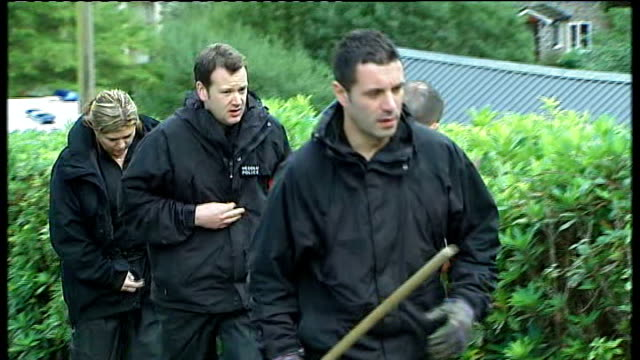 april jones abduction: police search continues; wales: powys: ceinws: ext police officers along during search back view police officers away - 中央ウェールズ点の映像素材/bロール