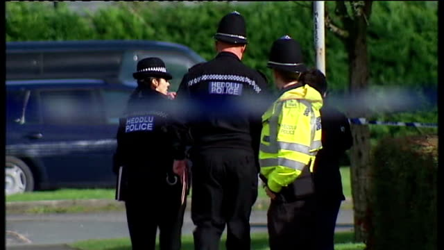 search continues / mother appeal 'heddlu' police tape across scene police on road missing appeal poster for april jones - missing poster stock videos & royalty-free footage