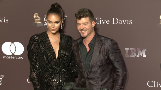april love geary and robin thicke at the clive davis' and the recording academy's pre-grammy gala at the beverly hilton hotel on february 09, 2019 in... - aprile video stock e b–roll